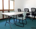 The small conference room - bright and open, functional and accessible.